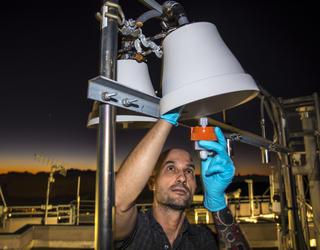 Engineer installing an atmospheric mercury detector