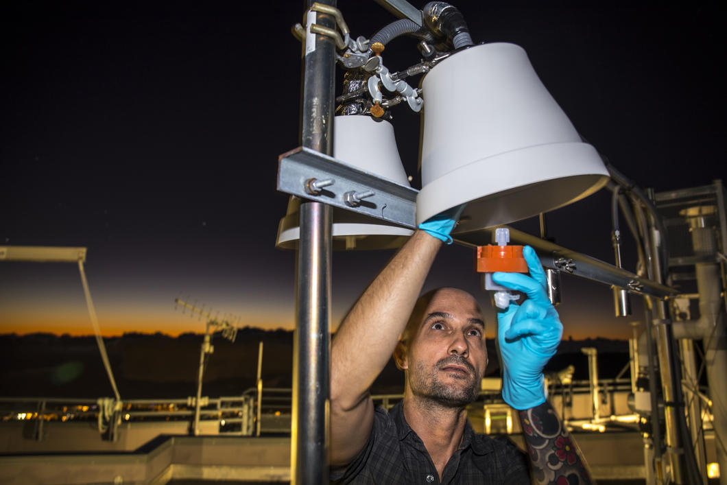 Engineer installing an atmospheric mercury detector