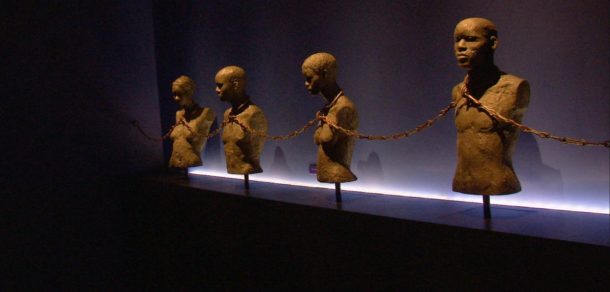 Memorial sculpture of enchained slaves.