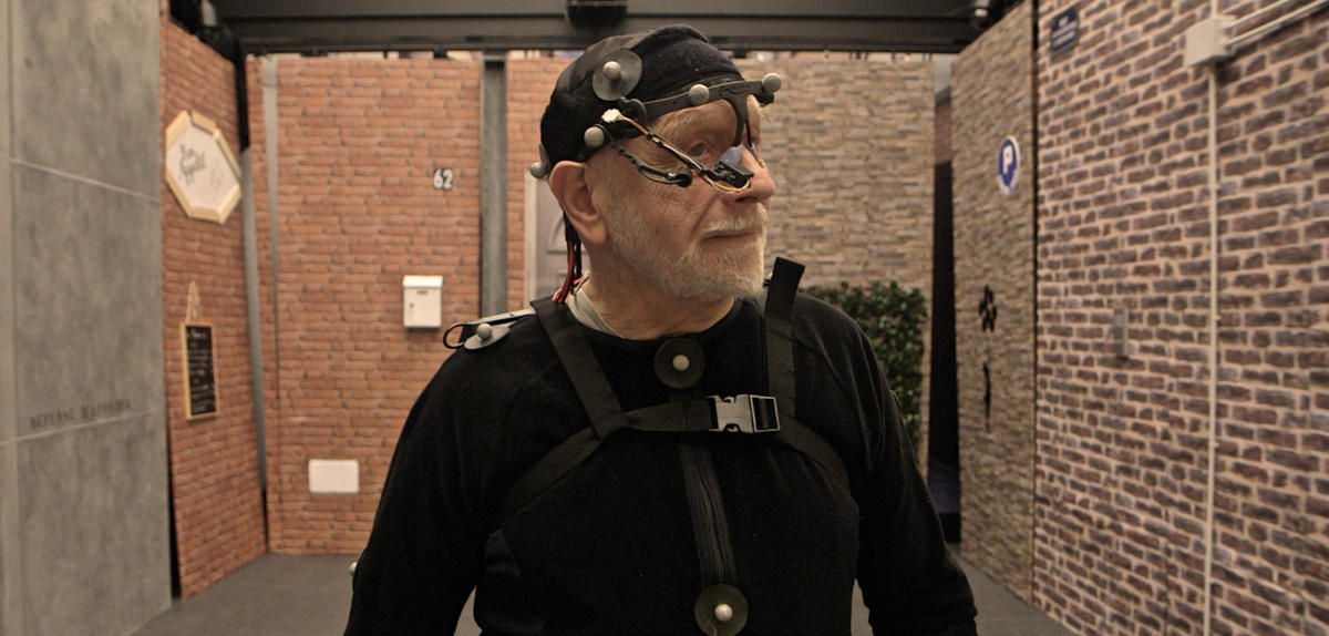 Senior with motion capture equipment on body and head
